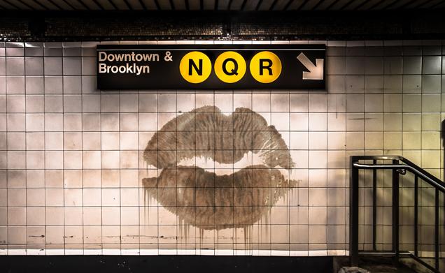 subway wall with kiss